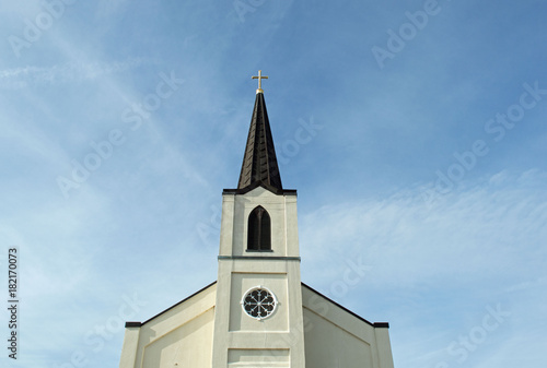 Leinwand Poster Christian background photo of a majestic church steeple with a cross and a clock