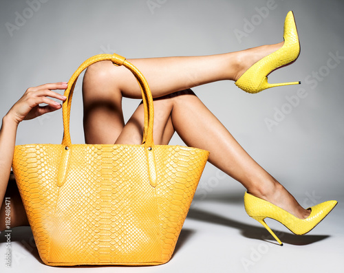 Part of women legs in beautiful fashionable high heels Fototapeta