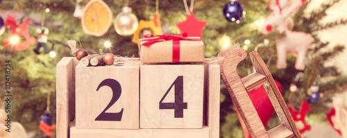 Billede på lærred Vintage photo, Date 24 December, wrapped gifts and christmas tree with decoratio