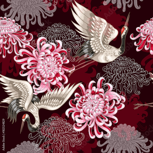 Seamless pattern with Japanese white cranes and chrysanthemums on a claret backg Fototapeta