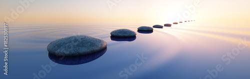 Steine im See bei Sonnenaufgang Querformat 3:1