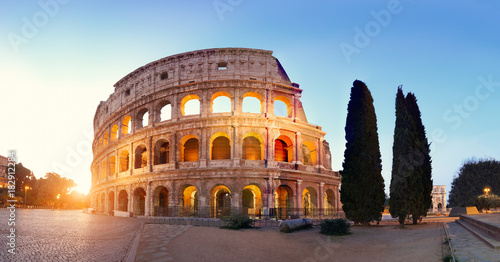 Leinwand Poster Panoramic image of Colosseum (Coliseum) in Rome, Italy