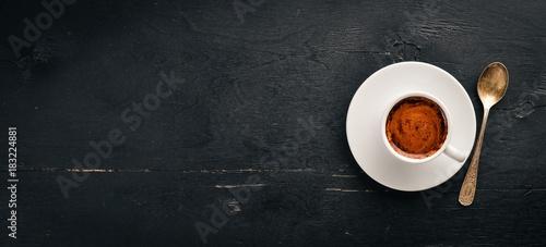 Obraz na plátně A cup of espresso coffee on a dark wooden background