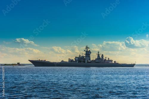 Leinwand Poster A warship on the horizon. Rocket cruiser.