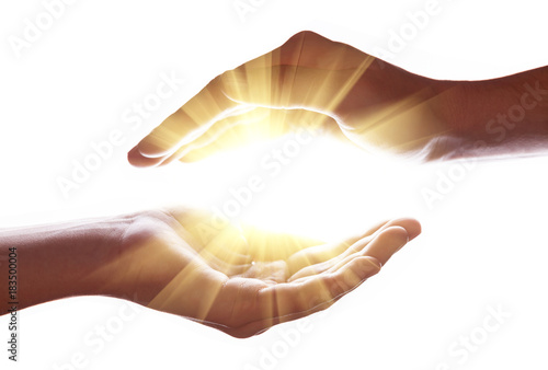 Woman hands protecting and containing bright, glowing, radiant, shining light Poster Mural XXL