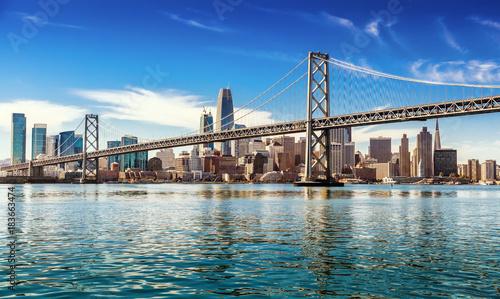 Photo Downtown San Francisco and Oakland Bay Bridge on sunny day