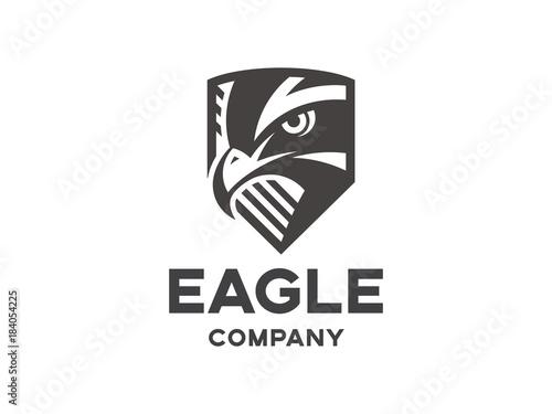 Obraz na płótnie Head of the eagle on the shield - black logo, mark, emblem on a white background