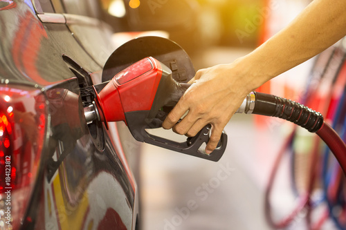 Tablou Canvas Pumping gas at gas pump
