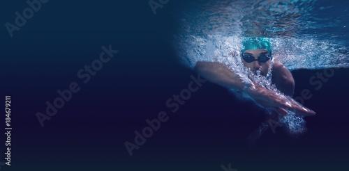 Wallpaper Mural Man swimming in blue water