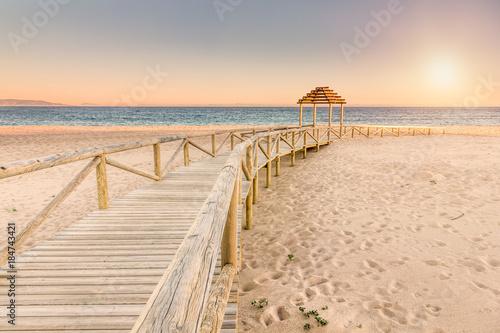 Obraz na płótnie Wooden boardwalk to the beach. Idyllic scene