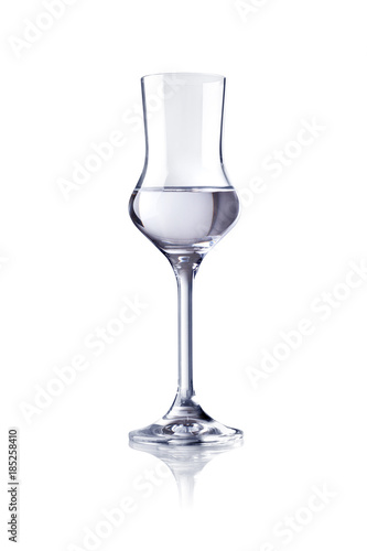 A glass of grappa on a white background Fototapeta