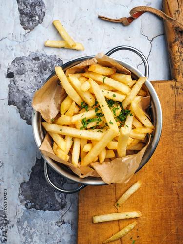 Vászonkép French fries on wooden table