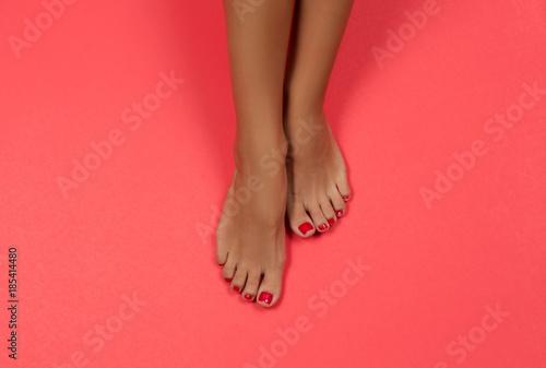 Beautiful female feet at spa salon on pedicure procedure
