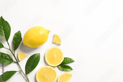 Composition with ripe lemons on white background