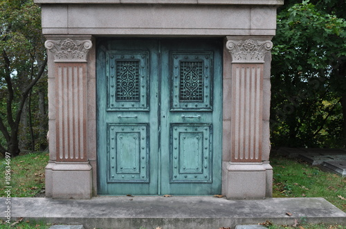 Canvas-taulu Blue Cast Iron Mausoleum Doors in a Cemetery