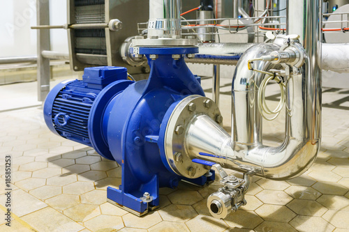 Photo Water Centrifugal pump and motor line with pipe rack in power plant construction