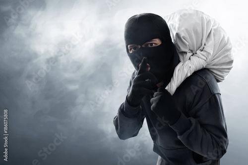 Wallpaper Mural Masked thief stealing