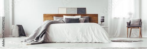 Vászonkép White bed in bright bedroom