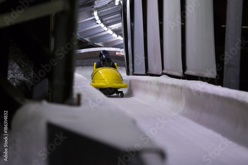 Canvas Print bob sled speeding in an ice channel