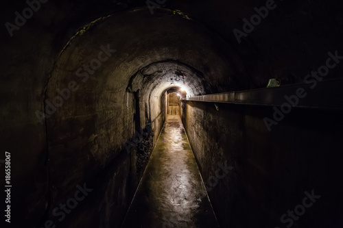 Dark corridor of old underground Soviet bunker under artillery fortification