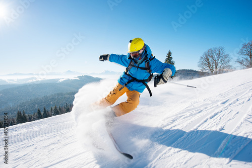 Canvas Print Shot of a professional skier riding the slope on a beautiful winter day copyspac