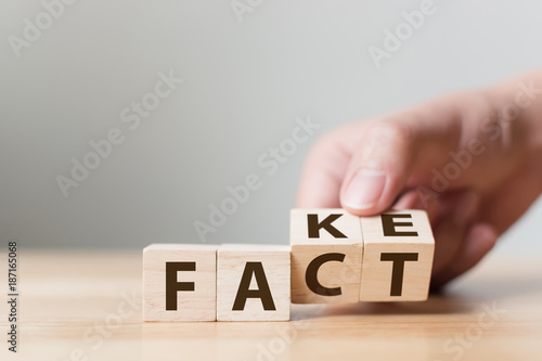 Fact or Fake concept, Hand flip wood cube change the word, April fools day Fototapet
