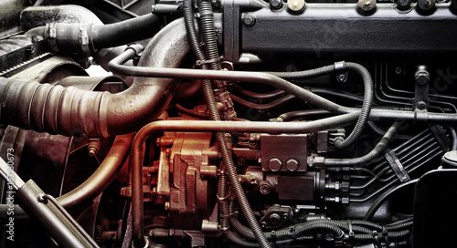 Fotografering A classic fragment of diesel car engine or truck engine with copy space for text