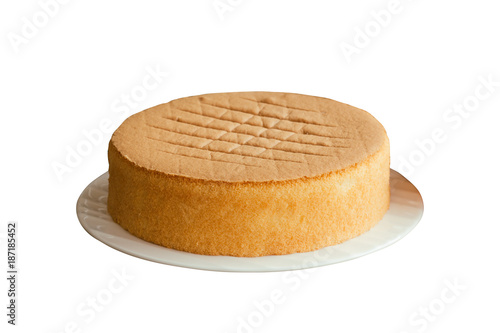 Canvas-taulu Homemade chiffon or sponge cake on white plate on white isolated background with clipping paths