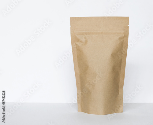 Brown paper bag on white background, eco packaging concept
