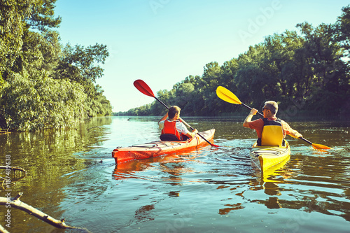 A canoe trip on the river in the summer. Poster Mural XXL
