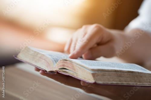 Fototapeta bible,women reading from the holy bible