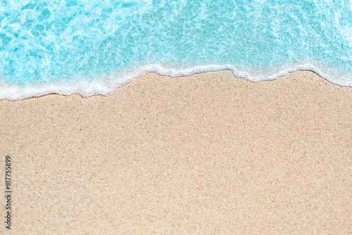 Carta da parati Background image of Soft wave of blue ocean on sandy beach