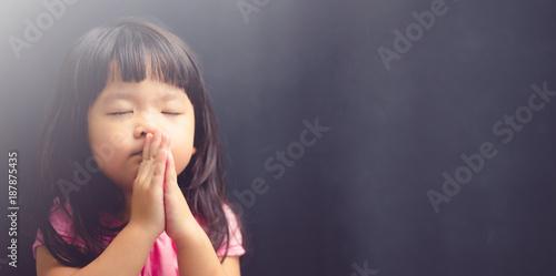Wallpaper Mural Little girl praying in the morning