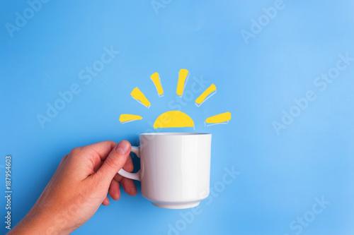 Obraz na plátne sun and white cup on blue background