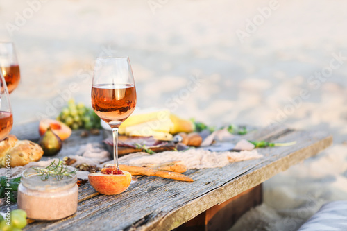 Glass of rose wine on rustic table