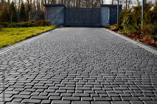 Fototapeta Cobblestone entrance in the garden, graphite paving stone texture, pavement