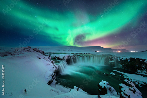 Canvas Print Godafoss waterfall with stunning aurora in the night sky of winter Iceland