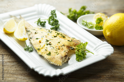 Fotografie, Tablou Flatfish, baked with lemon and herbs