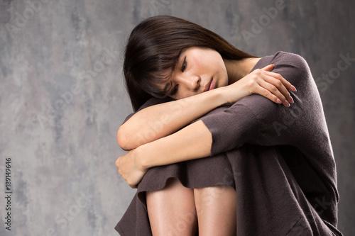 Valokuva 憂鬱な女性