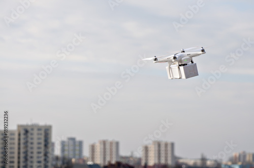 Technological delivery innovation - fast drone delivery concept above town