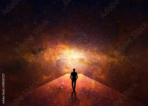 Tablou Canvas Man walking through the universe