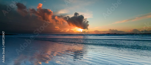 Photo Storm Clouds at sunset over West Wittering Beach, West Sussex, UK