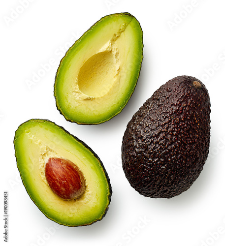 Whole and cut in half avocado