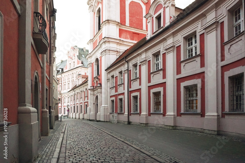 The ancient street of Poznan with the  monastery in perspective. Poland.