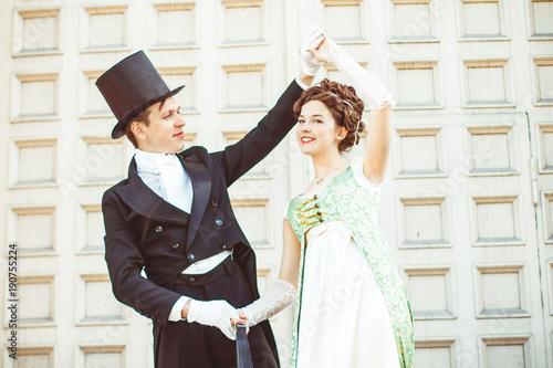 Photo couple in ballroom costumes
