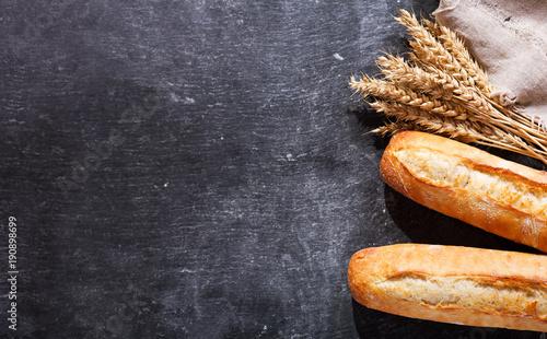 Fényképezés bread with wheat ears, top view