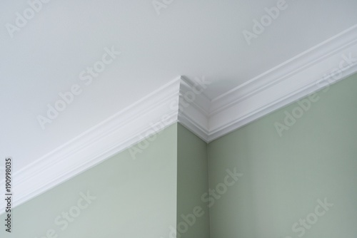 Photo Ceiling moldings in the interior, detail of intricate corner.