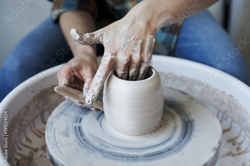 Fényképezés Close-up of hands doing a pot or a vase in ceramic studio, craft working process