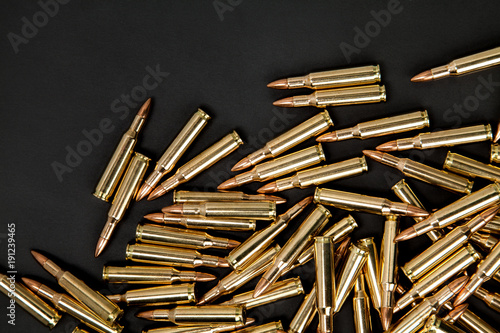 Fotografija Cartridges on a black background