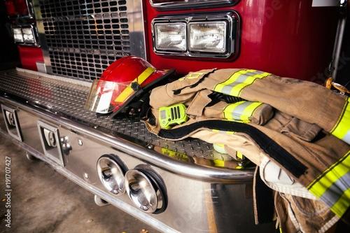 Fotografia, Obraz Firefighter gear helmet on a truck